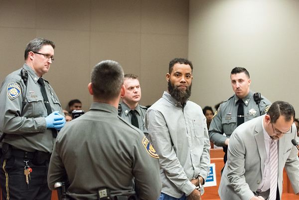 12/03/18 Wesley Bunnell | Staff Vincent Slaughter was arraigned in New Britain Superior Court on Monday afternoon in front of Judge Joan Alexander on several charges including Assault 1 and Criminal Weapon Possession. Slaughter is shown standing next to State Marshalls and his Defense Attorney Chester Fernandez, R.
