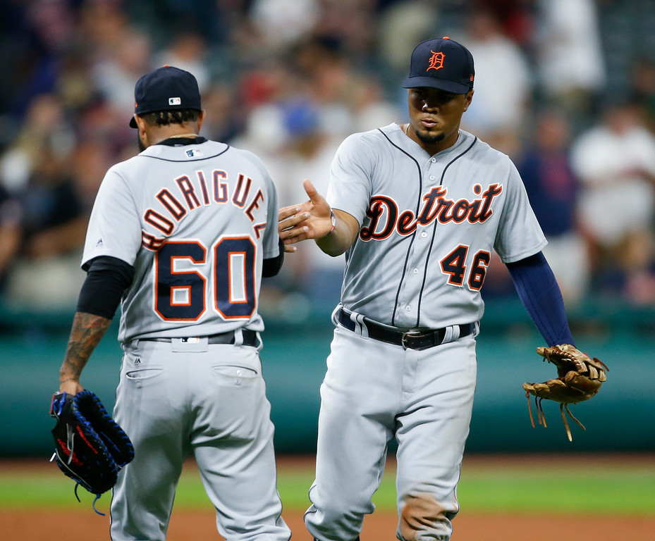 . Detroit Tigers\' Jeimer Candelario (46) and Ronny Rodriguez (60) celebrate a victory over the Cleveland Indians in a baseball game, Friday, Sept. 14, 2018, in Cleveland. (AP Photo/Ron Schwane)
