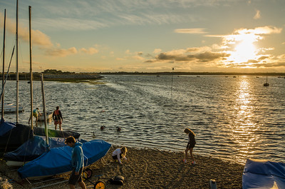 Returning sail boats as the sun sets over Chichester Harbour
