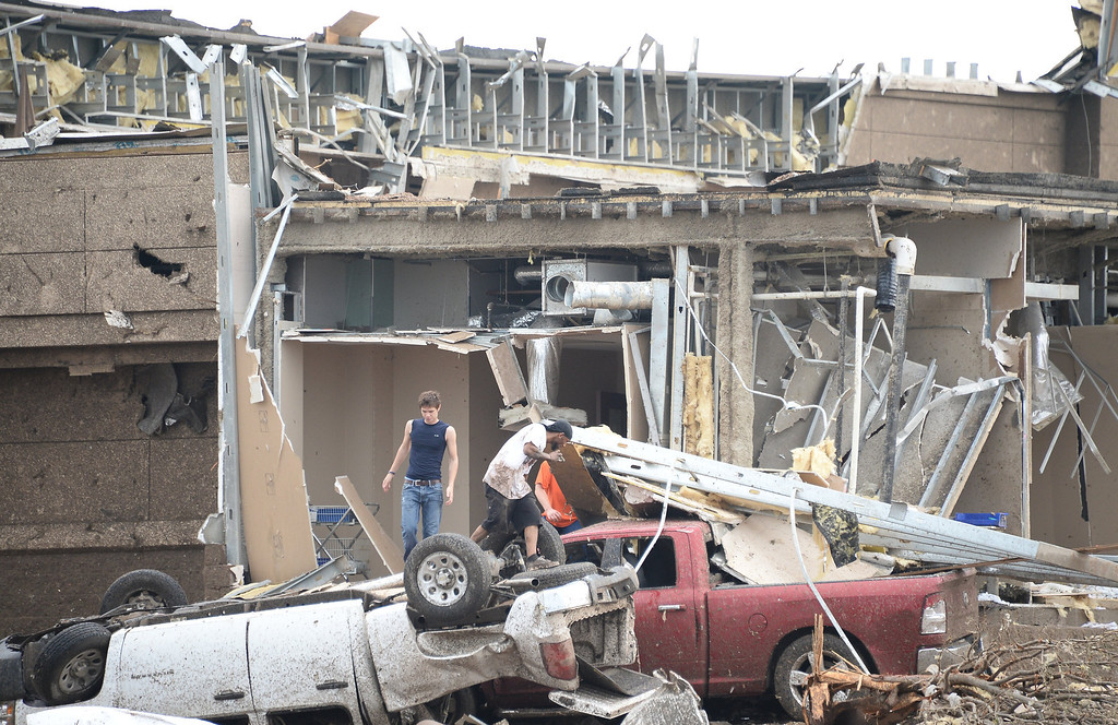 . People look for victims at the Moor hospital. A tornado devastated the Oklahoma City suburb of Moore on Monday, ripping up at least two elementary schools and a hospital and leaving a wake of tangled wreckage and death. 