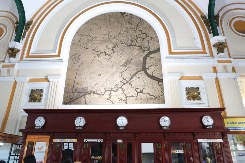 Hand painted maps above world clocks