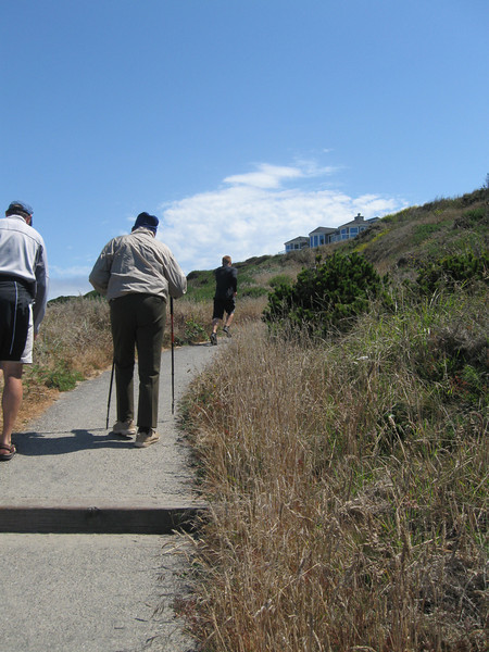 Dad climbing up the path from the beach after completing a flight of stairs.  Quite remarkable for 94 years old.