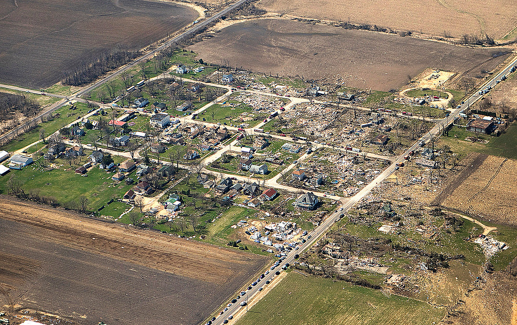 . This aerial photo shows a path destruction Friday, April 10, 2015, after a tornado swept through the small town of Fairdale, Ill., in DeKalb County Thursday night. The National Weather Service says at least two tornadoes churned through six north-central Illinois counties. Illinois Gov. Bruce Rauner on Friday declared DeKalb and Ogle counties affected by the severe storms and tornadoes as disaster areas.  (AP Photo/Daily Chronicle, Danielle Guerra)