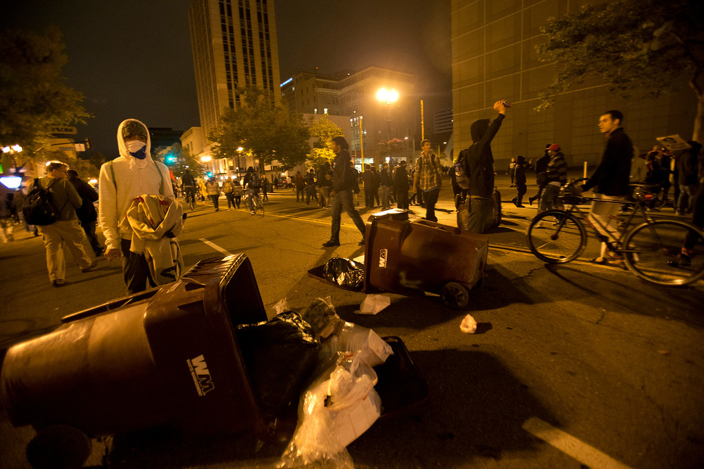 . Demonstrators litter Broadway with garbage cans during a protest of the verdict in the Trayvon Martin murder trial last Saturday in Sanford, Fla., Monday, July 15, 2013 in Oakland, Calif. (D. Ross Cameron/Bay Area News Group)