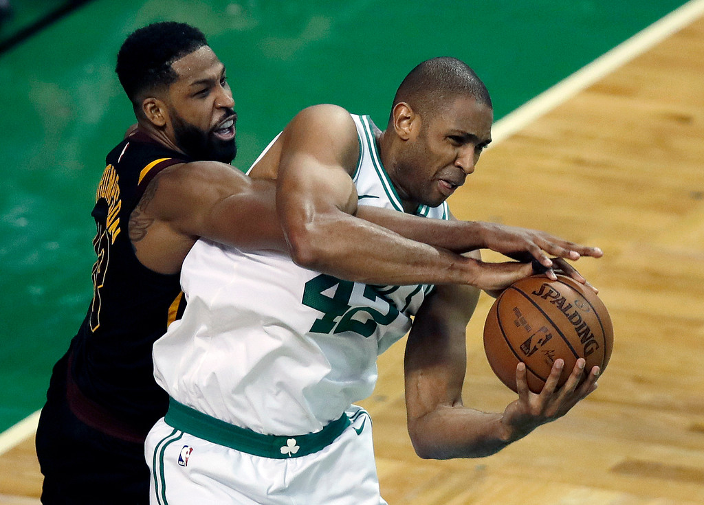 . Cleveland Cavaliers center Tristan Thompson, left, defends against Boston Celtics forward Al Horford during the second half in Game 7 of the NBA basketball Eastern Conference finals, Sunday, May 27, 2018, in Boston. (AP Photo/Charles Krupa)