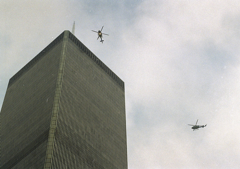 . Helicopters jockey for a position over the World Trade Center in New York following a noontime blast, which rocked the twin towers complex on February 26, 1993. (AP Photo/Ron Frehm, File)