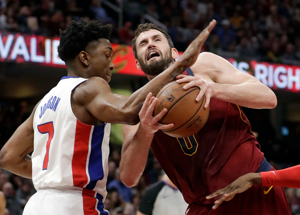 . Detroit Pistons\' Stanley Johnson, left, fouls Cleveland Cavaliers\' Kevin Love in the first half of an NBA basketball game, Sunday, Jan. 28, 2018, in Cleveland. (AP Photo/Tony Dejak)