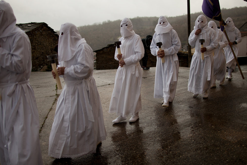 Description of . Penitents wearing capirote start their Holy Week procession of the Cofradia of Santo Entierro brotherhood on March 29, 2013 in Bercianos de Aliste near Zamora, Spain. The procession was finally stopped because of the rain. Easter week is traditionally celebrated with processions in most Spanish towns.  (Photo by Pablo Blazquez Dominguez/Getty Images)