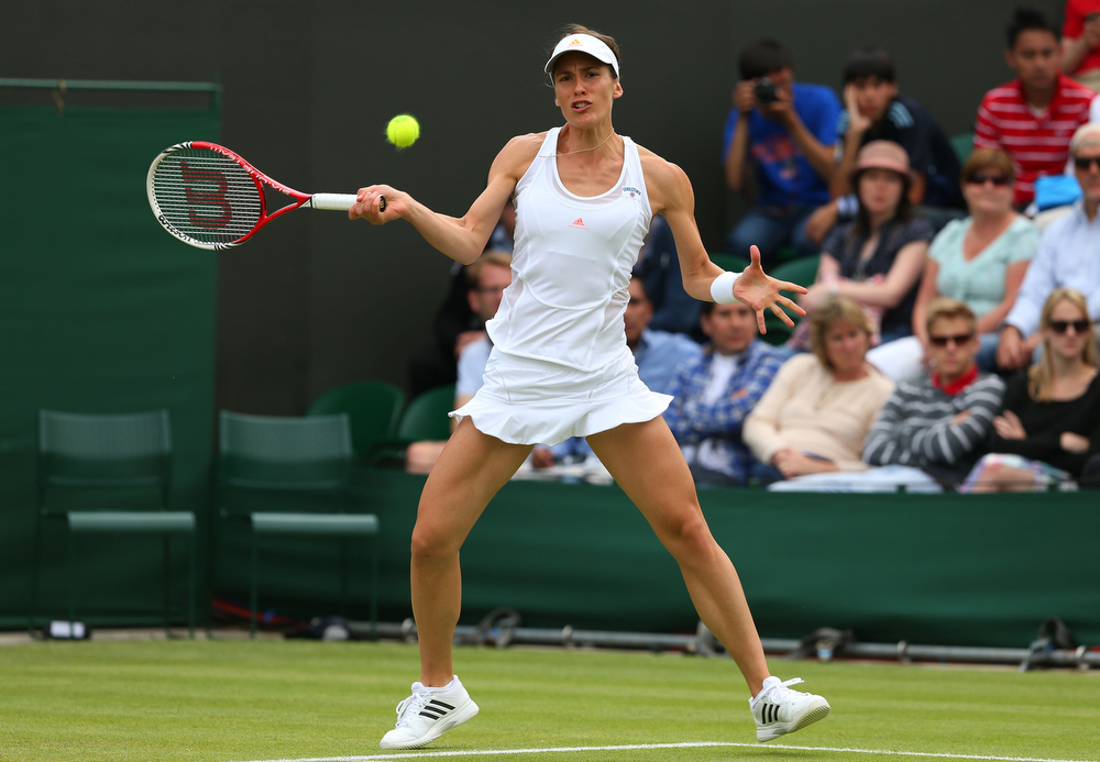 . Andrea Petkovic of Germany plays a forehand during her Ladies\' Singles second round match against Sloane Stephens of United States of America on day three of the Wimbledon Lawn Tennis Championships at the All England Lawn Tennis and Croquet Club on June 26, 2013 in London, England.  (Photo by Julian Finney/Getty Images)