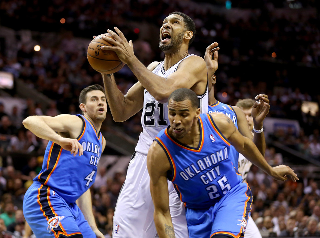 . Tim Duncan #21 of the San Antonio Spurs goes up for a shot against Thabo Sefolosha #25 of the Oklahoma City Thunder in the first quarter in Game Two of the Western Conference Finals during the 2014 NBA Playoffs at AT&T Center on May 21, 2014 in San Antonio, Texas.   (Photo by Ronald Martinez/Getty Images)