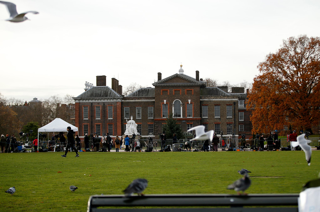 . TV crews set up outside Kensington Palace in London, Monday Nov. 27, 2017. Palace officials announced Monday that Prince Harry and Meghan Markle are engaged, and will marry in the spring. (AP Photo/Alastair Grant)