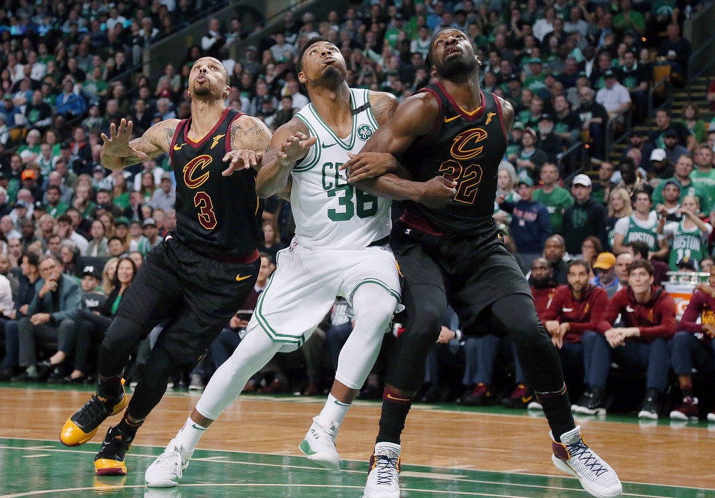 . Cleveland Cavaliers guard George Hill, left, and forward Jeff Green, right, fight for position with Boston Celtics guard Marcus Smart (36) during the second half in Game 7 of the NBA basketball Eastern Conference finals, Sunday, May 27, 2018, in Boston. (AP Photo/Elise Amendola)