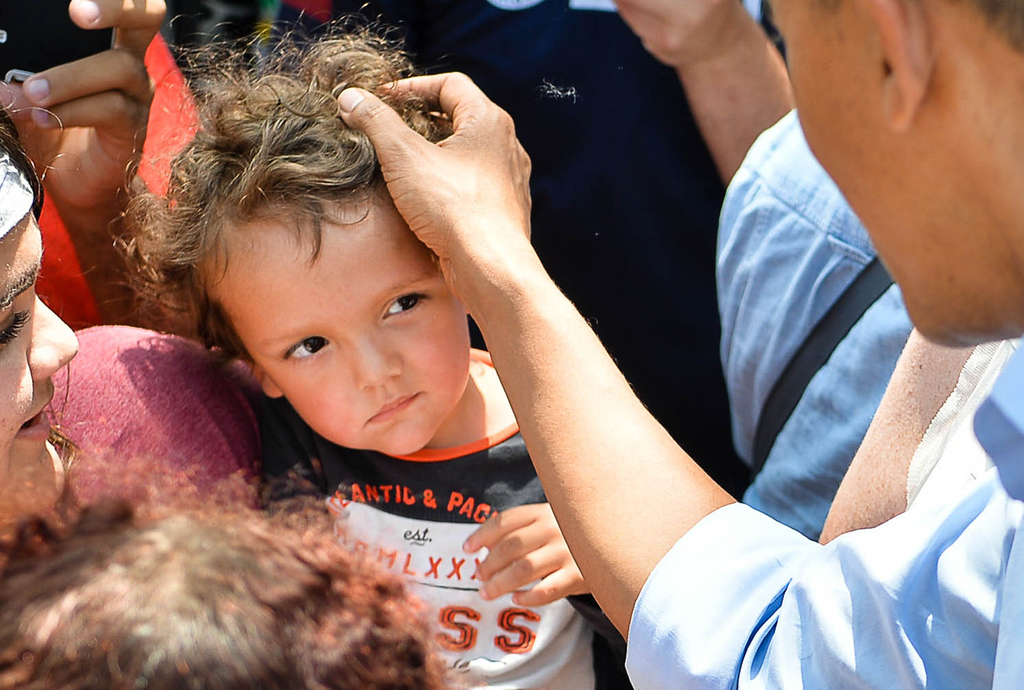 . A small child gets a Presidential pat on the head from Barack Obama outside Matt\'s Bar in Minneapolis on Thursday. (Pioneer Press: Ben Garvin)