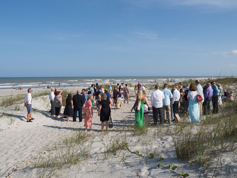 Friends and family gather for the beach wedding of Alicia Oakes and Adam Marrara, March 24, 2012, in Cocoa Beach, Florida