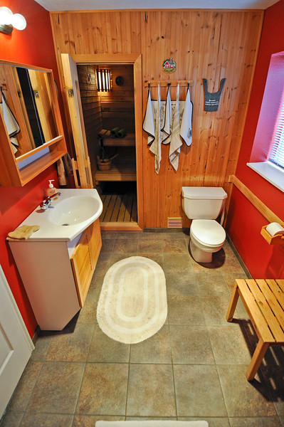 2011/5/28 – I finally finished the bathroom remodel and got everything put back together. It turned out great. I was a little worried about the bright red walls, but they go well with the new tile and natural wood. It was hard work, but a fun project.