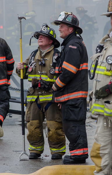 Sterling FF Jamie Shea chats with Leominster Lt Ryan Young at the 6th Alm on Sherman St in Gardner.