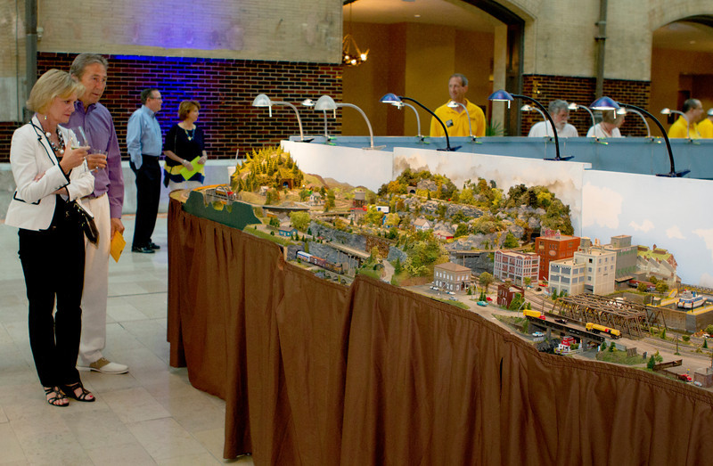 Guests view the award-winning modular layouts of the Mississippi Valley N Scalers displayed at St. Louis' Union Station VIP event.