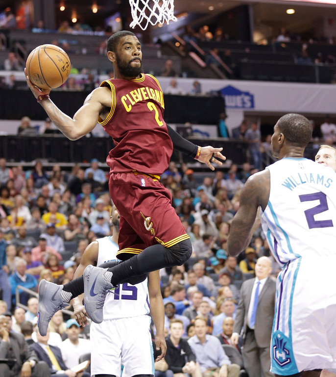 . Cleveland Cavaliers\' Kyrie Irving (2) looks to pass against the Charlotte Hornets in the second half of an NBA basketball game in Charlotte, N.C., Friday, March 24, 2017. The Cavaliers won 112-105. (AP Photo/Chuck Burton)