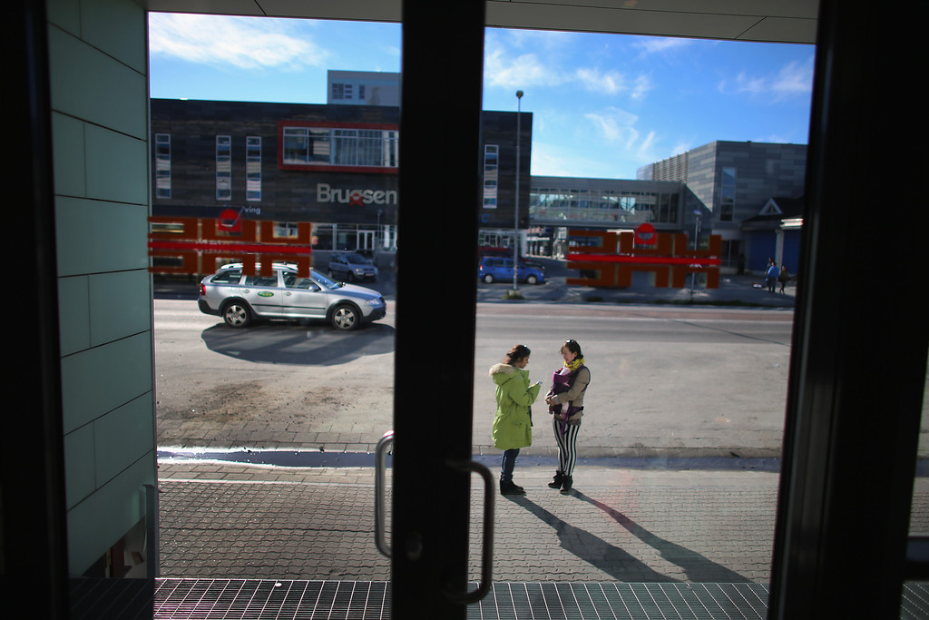 . Pedestrians are seen in the center of the business district on July 27, 2013 in Nuuk, Greenland. (Photo by Joe Raedle/Getty Images)