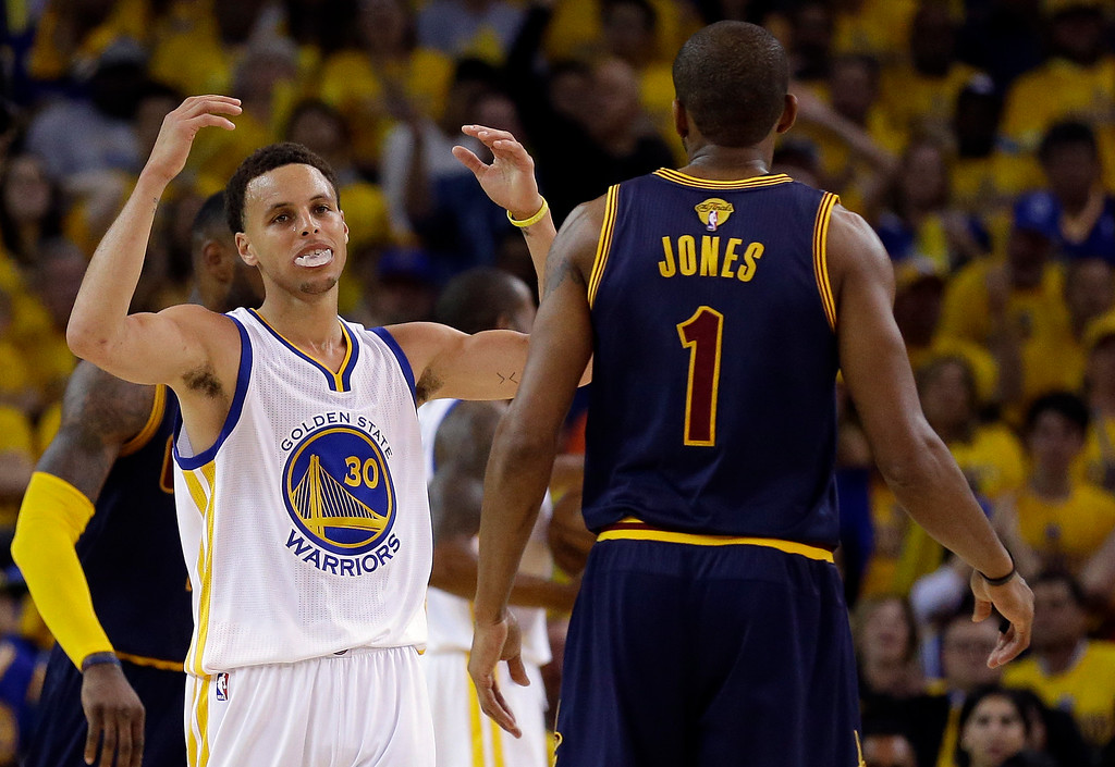 . Golden State Warriors guard Stephen Curry (30) reacts next to Cleveland Cavaliers forward James Jones (1) during the second half of Game 1 of basketball\'s NBA Finals in Oakland, Calif., Thursday, June 4, 2015. (AP Photo/Ben Margot)