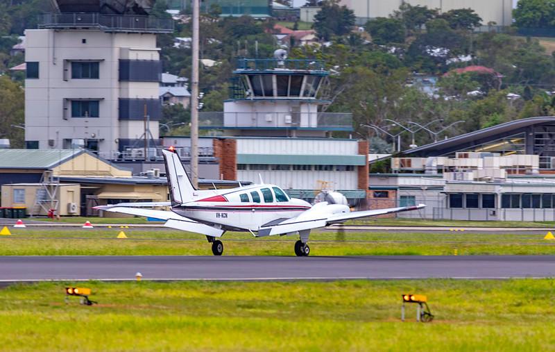 Beechcraft Baron 58 VH-KCN landing at Rockhampton Airport 06-02-19.