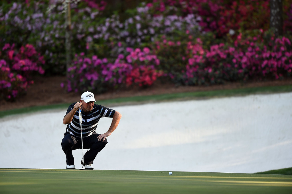 . Thomas Bjorn of Denmark lines up his putt shot on the 13th green during the third round of the 78th Masters Golf Tournament at Augusta National Golf Club on April 12, 2014 in Augusta, Georgia.   JIM WATSON/AFP/Getty Images