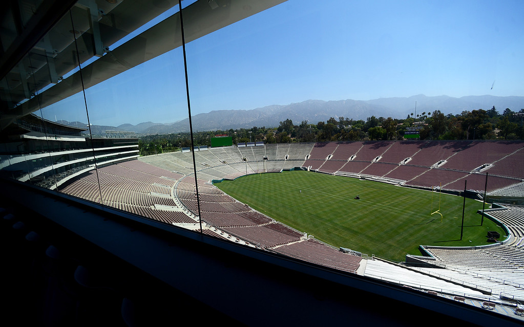 . The Rose Bowl Stadium is seen through the working press box Thursday, June 20, 2013 in advance of the historic stadium\'s first public tours, which begin Saturday. (SGVN/Staff Photo by Sarah Reingewirtz)