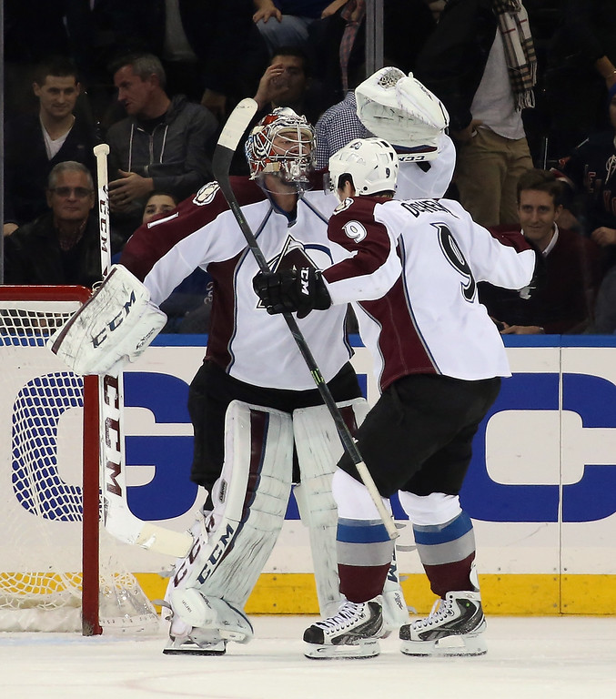 . NEW YORK, NY - NOVEMBER 13: Semyon Varlamov #1 and Matt Duchene #9 of the Colorado Avalanche celebrate their 4-3 shootout victory over the New York Rangers at Madison Square Garden on November 13, 2014 in New York City.  (Photo by Bruce Bennett/Getty Images)