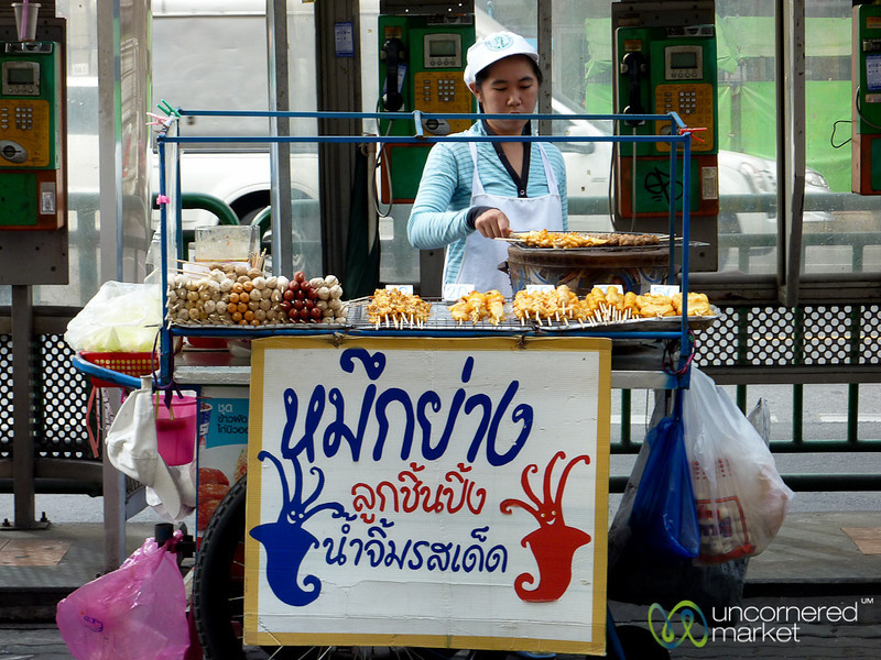 Grilling Squid on the Streets of Bangkok, Thailand