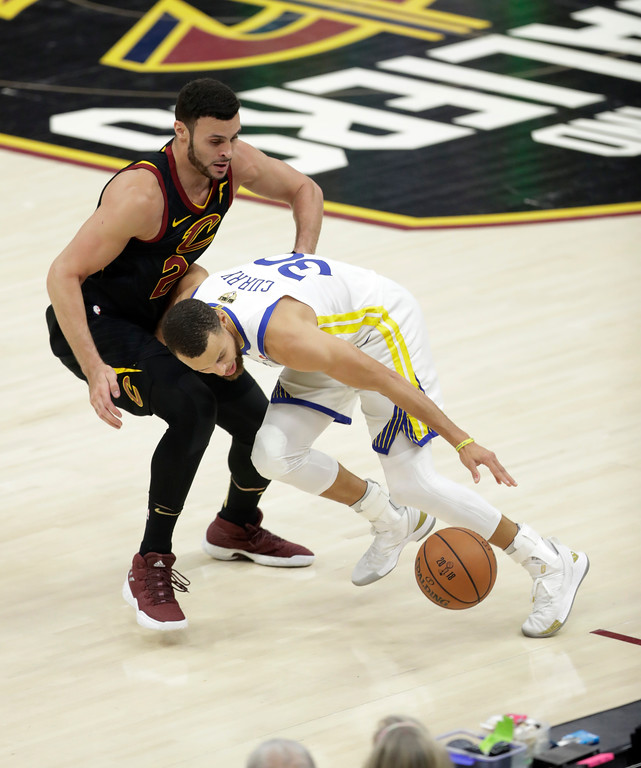 . Golden State Warriors\' Stephen Curry dribbles against Cleveland Cavaliers\' Larry Nance Jr. in the first half of Game 3 of basketball\'s NBA Finals, Wednesday, June 6, 2018, in Cleveland. (AP Photo/Tony Dejak)
