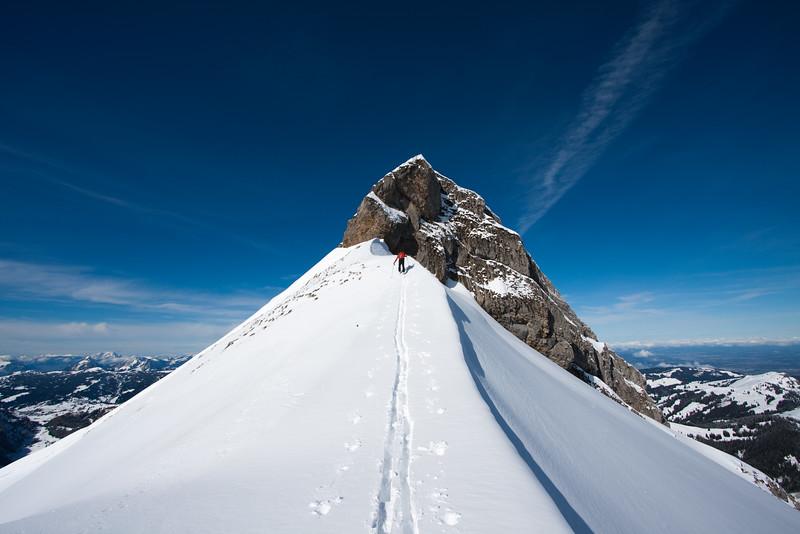 Climber nearing the summit scramble of Fluebrig, Swiss alps