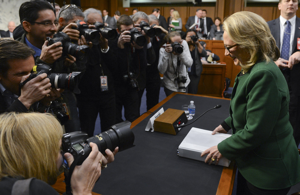 """. US Secretary of State Hillary Clinton leaves after testifying before the Senate Foreign Relations Committee on the September 11, 2012 attack on the US mission in Benghazi, Libya, during a hearing on Capitol Hill in Washington, DC, on January 23, 2013.   US Secretary of State Hillary Clinton on Wednesday warned of rising militancy in the wake of the Arab Spring, in an emotional and at times heated testimony into the deadly Benghazi attack.\""""Benghazi didn\'t happen in a vacuum,\"""" Clinton said at the start of a Senate hearing into the September 11 assault on a US mission in eastern Libya. \""""The Arab revolutions have scrambled power dynamics and shattered security forces across the region,\"""" she told the Foreign Relations committee called to review the lessons learned from the attack, in which US ambassador Chris Stevens and three other Americans were killed.AFP PHOTO / Saul LOEB        (Photo credit should read SAUL LOEB/AFP/Getty Images)"""