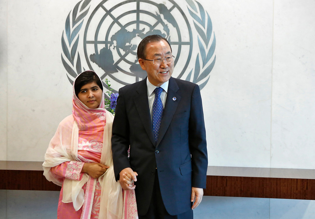 . Malala Yousafzai stands next to U.N. Secretary-General Ban Ki-moon (R) before giving her first speech since the Taliban in Pakistan tried to kill her for advocating education for girls, at the United Nations Headquarters in New York, July 12, 2013. Wearing a pink head scarf, Yousafzai told Ban and nearly 1,000 students from around the world attending a Youth Assembly at U.N. headquarters in New York that education was the only way to improve lives. REUTERS/Brendan McDermid