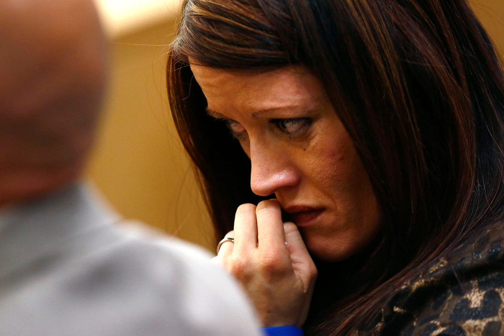 . Tanisha Sorenso turns away as autopsy photos of her brother Travis Alexander are displayed on Wednesday, May 15, 2013, during the sentencing phase of the Jodi Arias murder trial at Maricopa County Superior Court in Phoenix. If the jury finds aggravating factors in her crime, Arias could be sentenced to death. Jodi Arias was convicted of first-degree murder in the stabbing and shooting death of Travis Alexander, 30, in his suburban Phoenix home in June 2008. (AP Photo/The Arizona Republic, Rob Schumacher, Pool)
