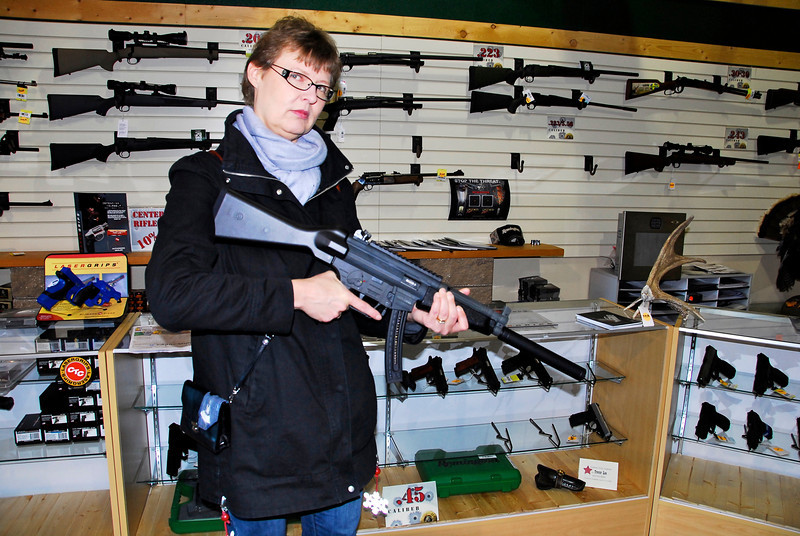 2011/11/15 – Raija's niece from Finland flew out for the funeral. We stopped by Steve and Nina's gun shop to show her their business. Since guns are not something Finns own, we thought it would be funny to stage her with an assault style riffle and take a photo. Funny for us Americans. I hope her family back in Finland isn't offended.