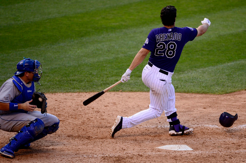 Description of . Nolan Arenado (28) of the Colorado Rockies loses his helmet while batting against the Los Angeles Dodgers during the Dodgers' 10-8 win in Denver on Monday, September 2, 2013. The Colorado Rockies hosted the Los Angeles Dodgers at Coors Field. (Photo by AAron Ontiveroz/The Denver Post)