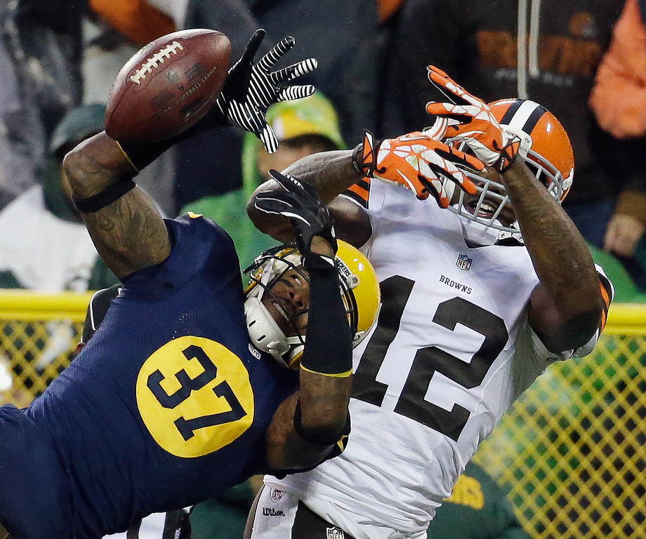 . Green Bay Packers\' Sam Shields (37) breaks up a pass intended for Cleveland Browns\' Josh Gordon (12) during the second half of an NFL football game Sunday, Oct. 20, 2013, in Green Bay, Wis. (AP Photo/Morry Gash)