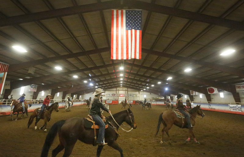 Riders warm up in the arena during the Cloverleaf Classic at Miller's Horse Palace on March 31, 2018.