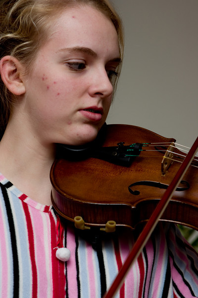 Claudia fiddling.