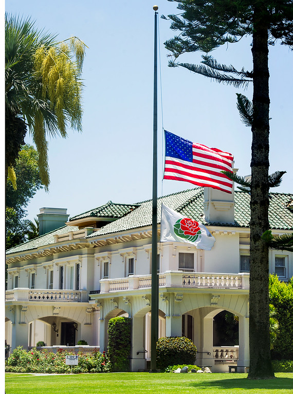 . Officials at the Tournament House lowered the American Flag and Rose Parade Flag to half-mask because of the passing of Louis Zamperini, war hero, Olympic distance runner, 2015 Rose Parade grand marshal, who has died at age 97. (Photo by Walt Mancini/Pasadena Star-News)