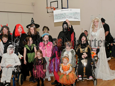 Rathore School Annual Halloween Party on Friday last. Cheque for £557.75 presented to Jenns for Genes Day.06W44N23