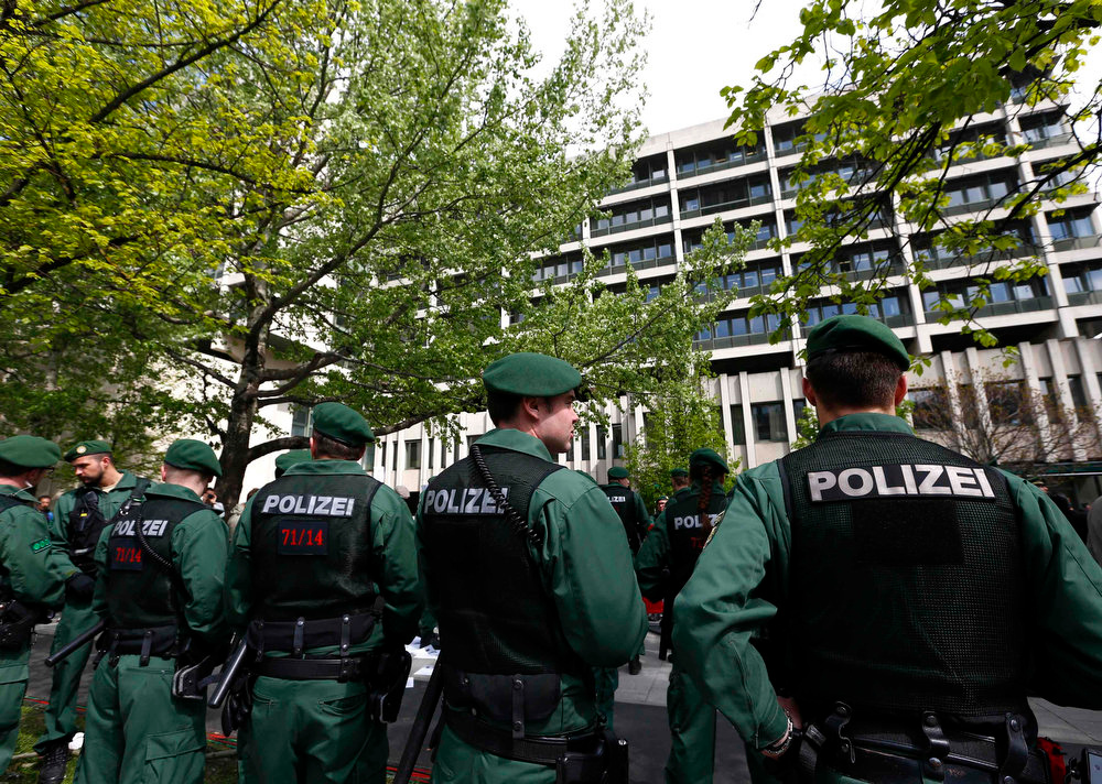 . German police officers stand in front of the courthouse in Munich on May 6, 2013. The surviving member of a German neo-Nazi cell went on trial on Monday for a series of racist murders that scandalized Germany and exposed authorities\' inability or reluctance to recognize right-wing hate crime. Beate Zschaepe, 38, is charged with complicity in the murder of eight Turks, a Greek and a German policewoman between 2000 and 2007, as well as two bombings in immigrant areas of Cologne and 15 bank robberies. REUTERS/Michaela Rehle