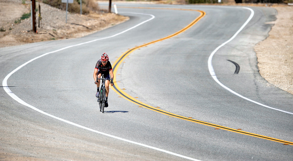 . Jamis-Hagens Berman team member Tyler Wren #135 makes his way along  Bouquet Canyon Rd in Santa Clarita during Stage 3 from Palmdale to Santa Clarita of the Amgen Tour of California bicycle race Tuesday, May 14, 2013. (Hans Gutknecht/Los Angeles Daily News)