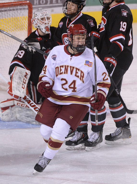 . DENVER, CO. - JANUARY 10: Denver right wing Evan Ritt (24) celebrated the first Pioneers goal in the first period. The University of Denver hockey team hosted St. Cloud State at Magness Arena Friday night, January 10, 2014. Photo By Karl Gehring/The Denver Post