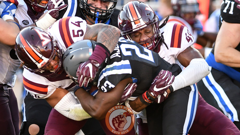 Virginia Tech linebackers Andrew Motuapuaka (54) and Tremaine Edmunds (49) bring down Duke running back Joseph Ajeigbe (23).  (Michael Shroyer/TheKeyPlay.com)