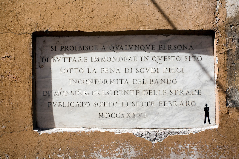 18th century stone plaque containing a warning message about disposal of waste on the street, Via del Leone, Rome