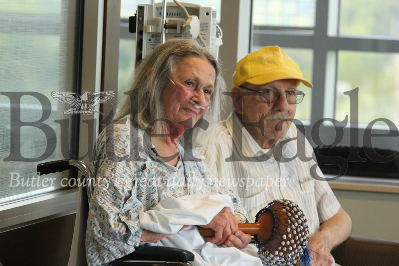 Shirley Wallace and her husband Joe follow along during a music therapy session at Butler Memorial Hospital Wednesday. Seb Foltz/Butler Eagle