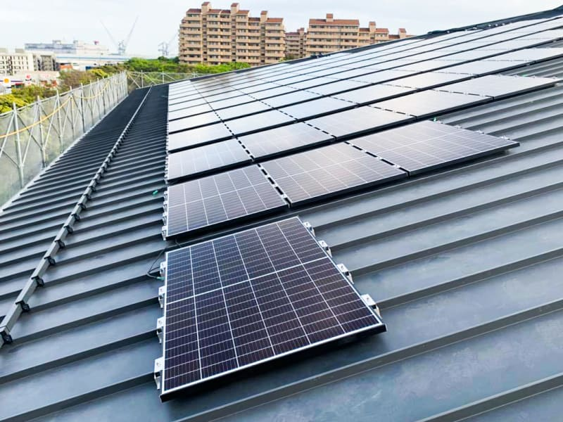 Eighty-four solar panels are installed on the east side of the South Building's angled roof.