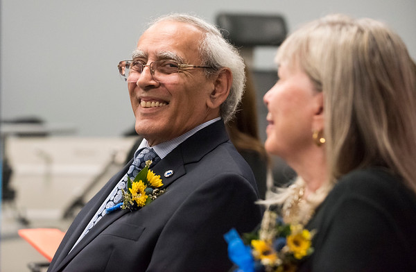 10/03/19 Wesley Bunnell | StaffrrCCSU officially opened the Dr. Antone B. Capitao Biomechanics Laboratory Classroom with a ribbon cutting on Thursday October 3, 2019. Dr. Capitao smiles as he looks over at his wife