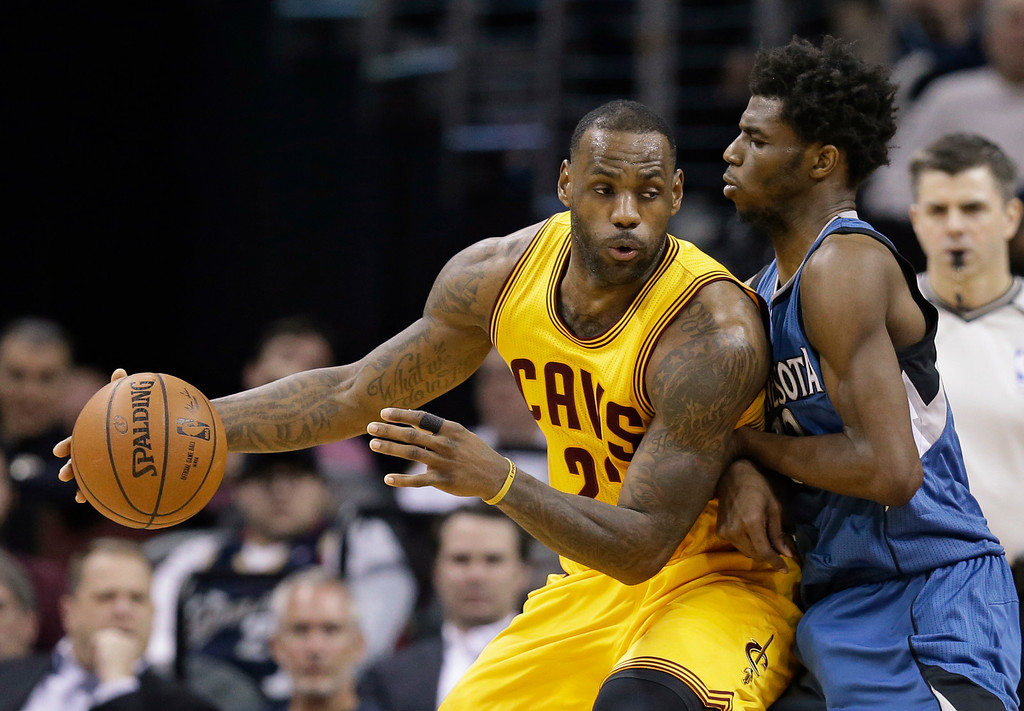 . Cleveland Cavaliers\' LeBron James, left, drives past Minnesota Timberwolves\' Andrew Wiggins, from Canada, in the second half of an NBA basketball game Monday, Jan. 25, 2016, in Cleveland. The Cavaliers won 114-107. (AP Photo/Tony Dejak)